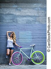 Standing with a bike - Young girl is standing with her bike