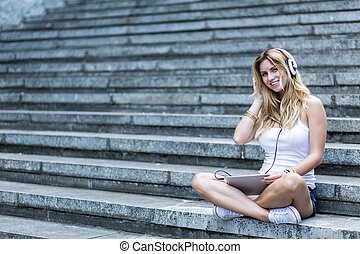 Girl and music - Girl is listening to the music on the...