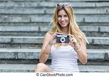 Taking a picture - Pretty girl is taking a picture,...