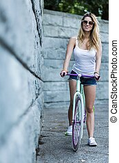 Active young girl likes riding a bike