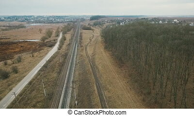 Aerial view: road, track, path, high-voltage network in...