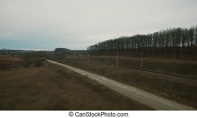 Aerial view: road in the fields, high-voltage network, trees...