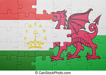 puzzle with the national flag of wales and tajikistan...