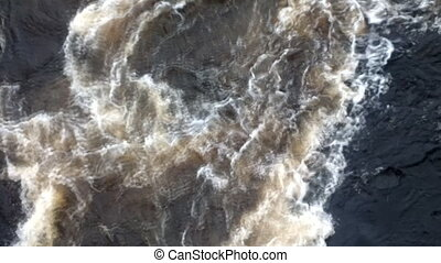 Powerful swirl of falling water from dam 2 - Powerful swirl...