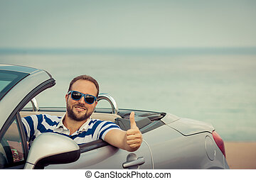 Happy man travel by car to the sea Person having fun in...