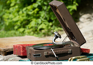Vintage gramophone with vinyl plate on the street