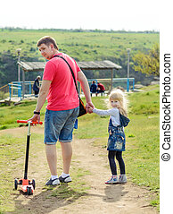 Adorable little blond girl with her father - Adorable little...