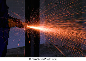 Angle grinder sparks - Sparks from an angle grinder as it...