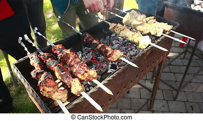 Juicy slices of meat with sauce prepare on fire kebab -...