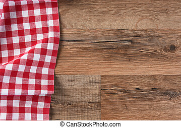 Red Checkered Table Cloth - Checkered table cloth on a wood...