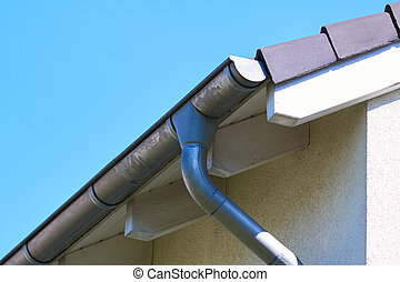 gutter - Gutter with downpipe on the roof of a house.