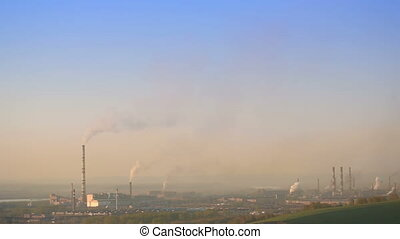 Factory pipe polluting air, ecology theme, the smoke from the chimneys