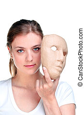 Woman and mask. - Young woman holding a mask in front of her...
