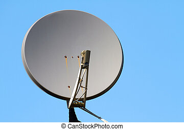 Satellite dish on the roof of a house