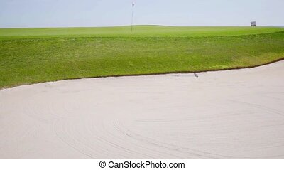 Sand bunker on a golf course - View onto the neatly...