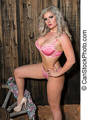 Blonde in pink - Beautiful statuesque blonde dressed in pink...