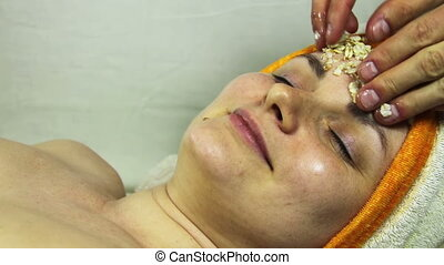 Home Cosmetic Mask of Oatmeal on the Girls Face Happy Woman...
