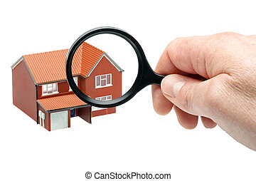 Examining a house through a magnifying glass