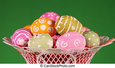 Easter eggs in basket on green - Easter eggs in basket...