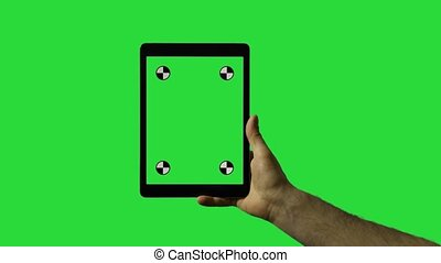 Closeup of man's hand sliding on tablet green screen HD