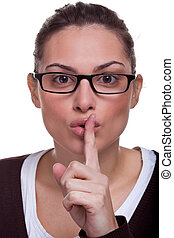 Sshh - Attractive female with her finger to her mouth...