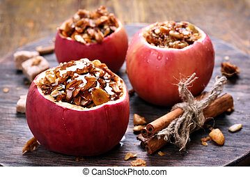 Baked apples stuffed with granola - Fruit dessert baked red...