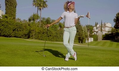 Pretty young woman golfer posing with the ball - Pretty...