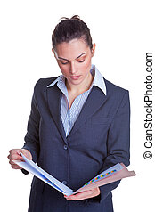 Businesswoman reading a file - Businesswoman reading some...
