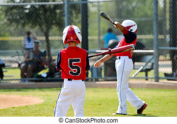 Youth baseball boys batting - Young baseball player on deck...