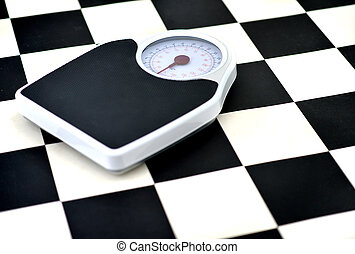 Weighing scales - bathroom weighing scales on black and...