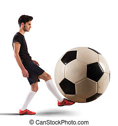 Big soccerball - Teenage soccer player plays with big...