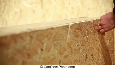 Carpenter screw screwdriver spin into a sheet of plywood...