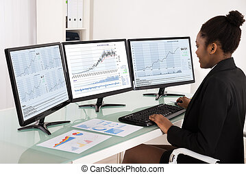 African Businesswoman Analyzing Data