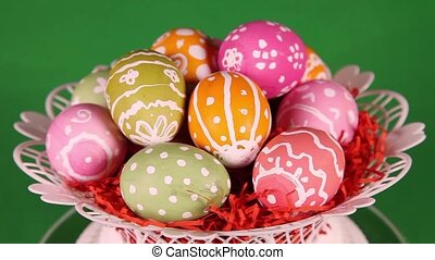 Easter eggs on green background - Easter eggs in basket...