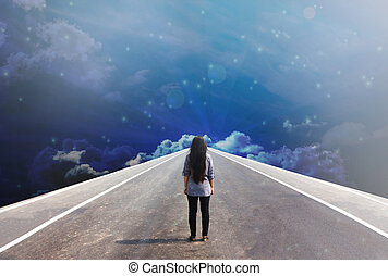 Back or rare of women standing on the road in dreamy fantasy sky