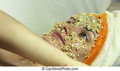 Home Cosmetic Mask of Oatmeal on the Girl's Face - Girl in a...