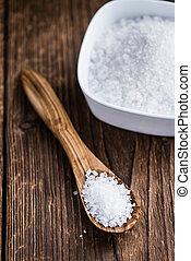 Heap of Coarse Salt close-up shot on vintage background...