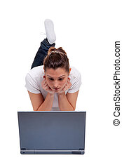 Young woman on a laptop computer - Young woman in casual...