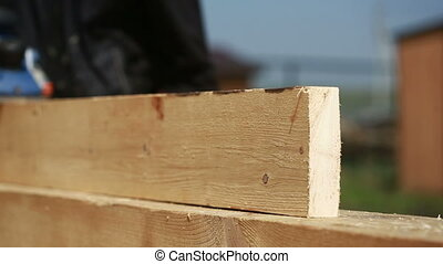 carpenter cut wood for house construction Wood construction