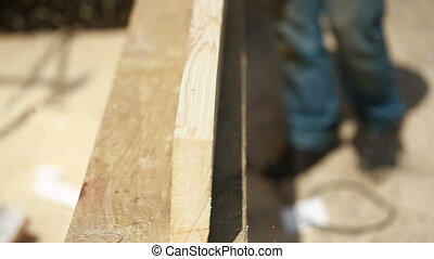 carpenter cut wood for house construction. Wood construction