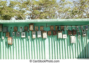 electricity meter wall in mexico outdoor green aged vintage