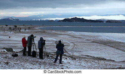 photographers work using tripods - The group of photographer...