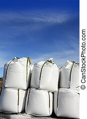salt white sacks rows stacked to road ice