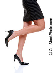 Short skirt long legs and high heels - Womans legs wearing a...