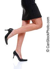 Short skirt long legs and high heels - Womans legs wearing a...