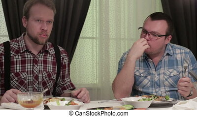 Men sitting at the dinner table in a cafe