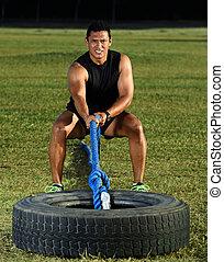sport man pull tire