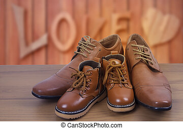 Parent and child shoes, fathers day concept.