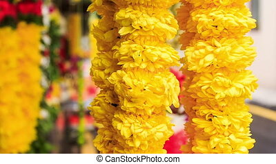 Wind Shakes Yellow and Red Flower Garlands - closeup wind...