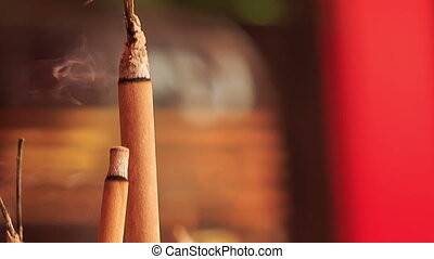 Smoke Flame of Burning Stick in Indian Temple - closeup...